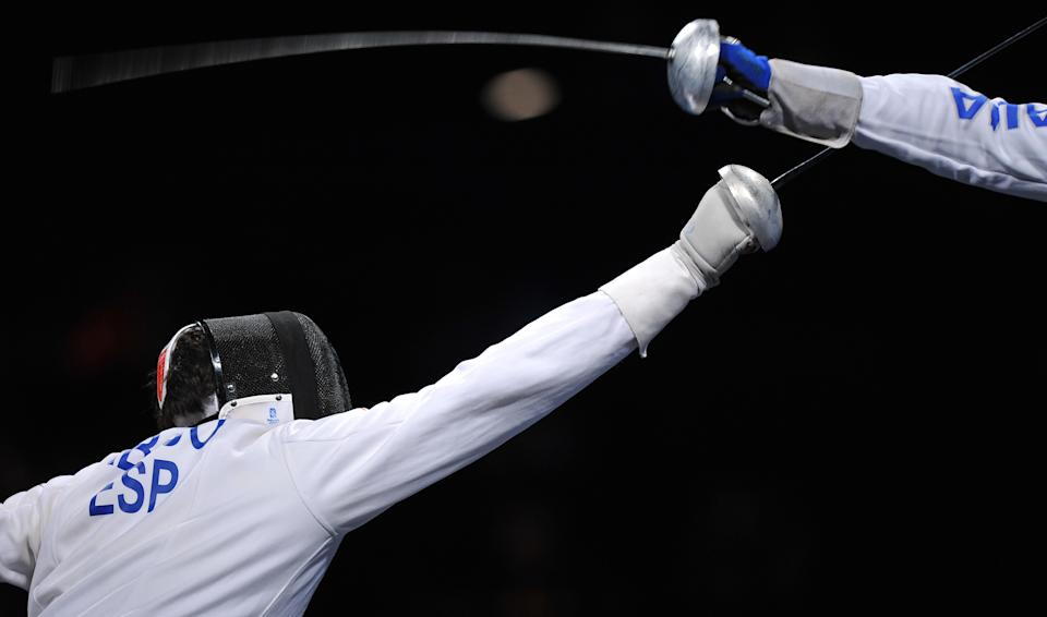 Spain's Jose Luis Abajo (L) competes against Italy's Matteo Tagliariol during their men's individual Epee semi-final match on August 10, 2008 at the Fencing Hall of National Convention center in Beijing, as part of the 2008 Beijing Olympic games. Tagliariol won 15-12.           AFP PHOTO / PHILIPPE DESMAZES (Photo credit should read PHILIPPE DESMAZES/AFP via Getty Images)