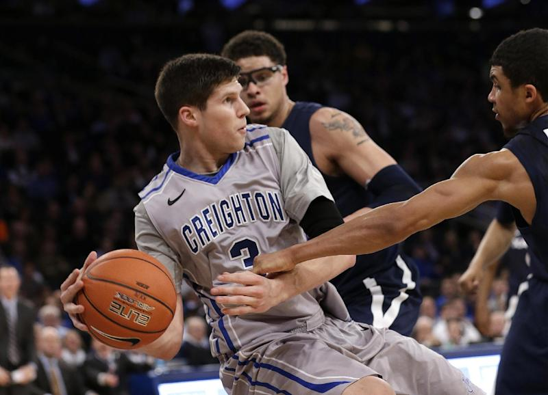Creighton's Doug McDermott fights for control of the ball with Xavier's Dee Davis during the first half of an NCAA college basketball game in the semifinals of the Big East Conference men's tournament Friday, March 14, 2014, at Madison Square Garden in New York. (AP Photo/Frank Franklin II)