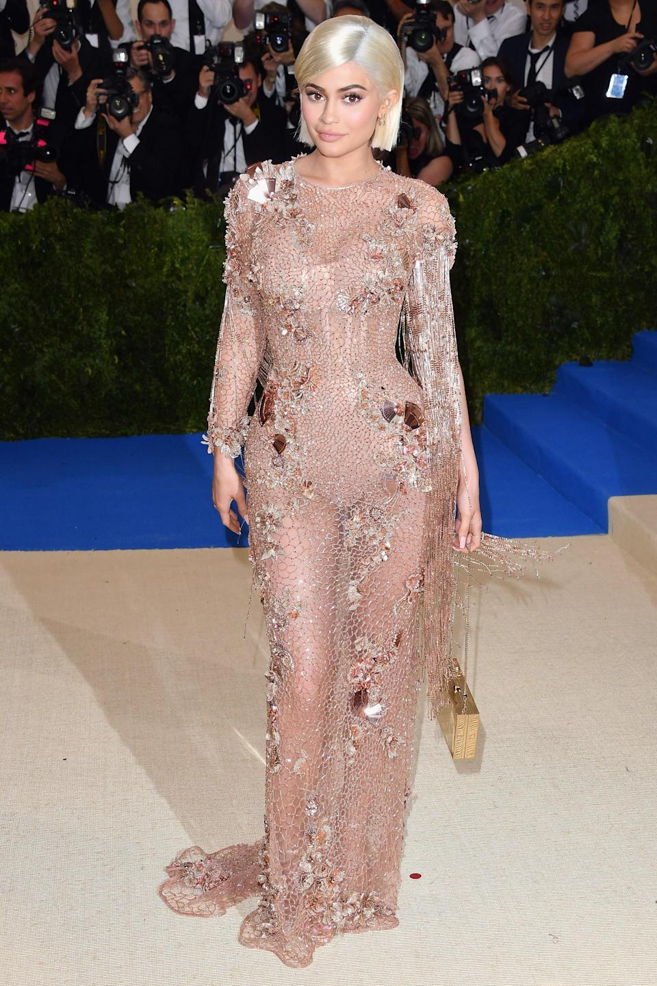 """<p>On the other hand, Kylie took a sexier approach in 2017. Just look at her <a href=""""https://www.popsugar.com/fashion/Kylie-Jenner-Versace-Dress-2017-Met-Gala-43489637"""" class=""""link rapid-noclick-resp"""" rel=""""nofollow noopener"""" target=""""_blank"""" data-ylk=""""slk:custom Versace Met Gala"""">custom Versace Met Gala</a> look!</p>"""