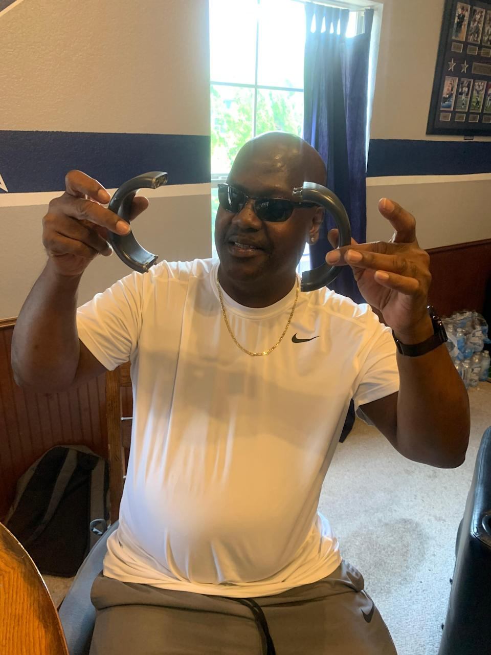 Curtis Flowers, 50, holds up his disassembled ankle monitor after Mississippi Attorney General Lynn Fitch dropped the case against him Sept. 5, 2020. Flowers was tried six times in the murder of four people at a furniture store in Winona. Flowers' last conviction was overturned because the U.S. Supreme Court found that prosecutor Doug Evans racially discriminated during jury selection.