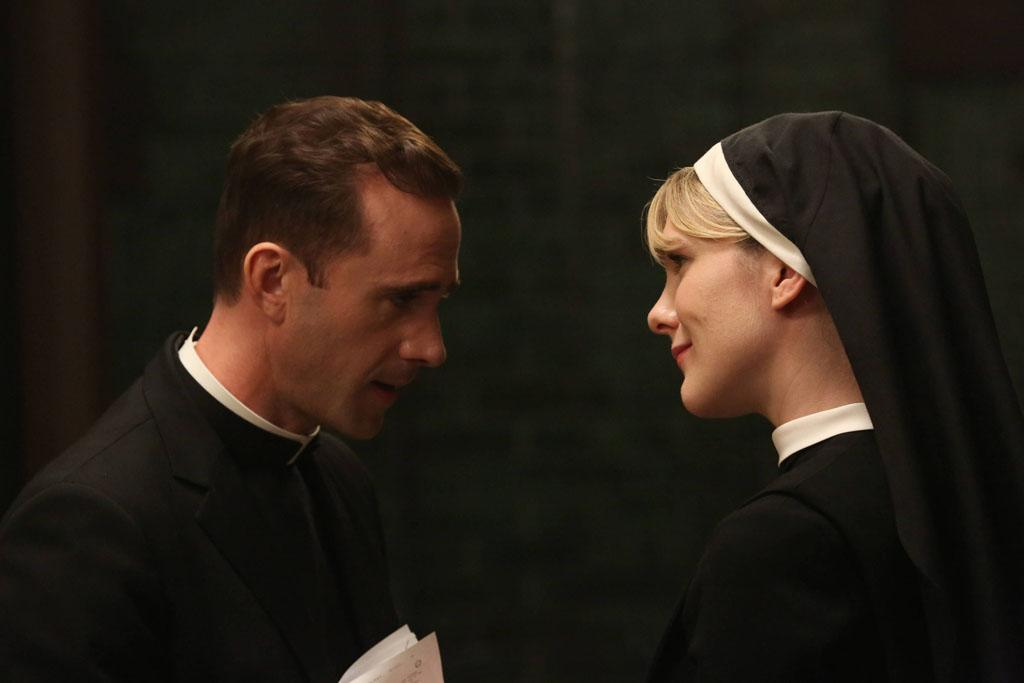 """Joseph Fiennes as Monsignor Timothy Howard and Lily Rabe as Sister Eunice in the """"American Horror Story: Asylum"""" episode, """"Unholy Night."""""""