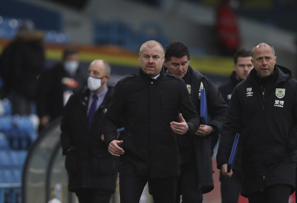 Burnley's manager Sean Dyche, centre, leaves after the first half time during the English Premier League soccer match between Leeds United and Burnley at Elland Road Stadium in Leeds, England, Sunday, Dec. 27, 2020. (Molly Darlington/Pool via AP)