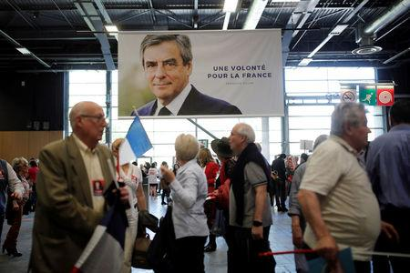Supporters of French centre-right presidential candidate Francois Fillon arrive to attend a political rally in Paris, France, April 9, 2017. REUTERS/Benoit Tessier