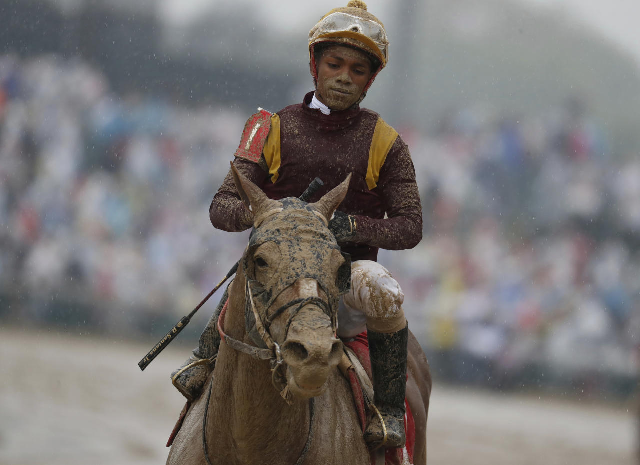 <p>Ricardo Santana Jr. is covered in mud after riding Whitmore in a race before the 144th running of the Kentucky Derby horse race at Churchill Downs Saturday, May 5, 2018, in Louisville, Ky. (Photo: John Minchillo/AP) </p>