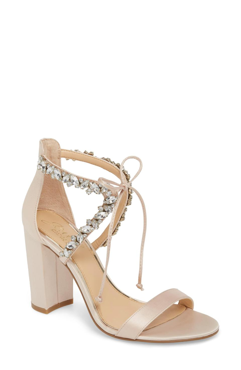 """<p><strong>JEWEL BADGLEY MISCHKA</strong></p><p>nordstrom.com</p><p><strong>$109.00</strong></p><p><a href=""""https://go.redirectingat.com?id=74968X1596630&url=https%3A%2F%2Fwww.nordstrom.com%2Fs%2Fjewel-badgley-mischka-thamar-embellished-sandal-women%2F4887682&sref=https%3A%2F%2Fwww.thepioneerwoman.com%2Ffashion-style%2Fg36122557%2Fcomfortable-wedding-shoes%2F"""" rel=""""nofollow noopener"""" target=""""_blank"""" data-ylk=""""slk:Shop Now"""" class=""""link rapid-noclick-resp"""">Shop Now</a></p><p>The ankle tie is much more flexible and stylish than a normal strap, especially when combined with gorgeous jewels. Pick from the champagne shade, black, or silver options available.</p>"""