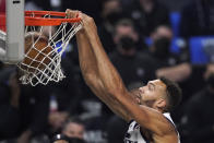 Utah Jazz center Rudy Gobert dunks during the first half in Game 6 of a second-round NBA basketball playoff series against the Los Angeles Clippers Friday, June 18, 2021, in Los Angeles. (AP Photo/Mark J. Terrill)