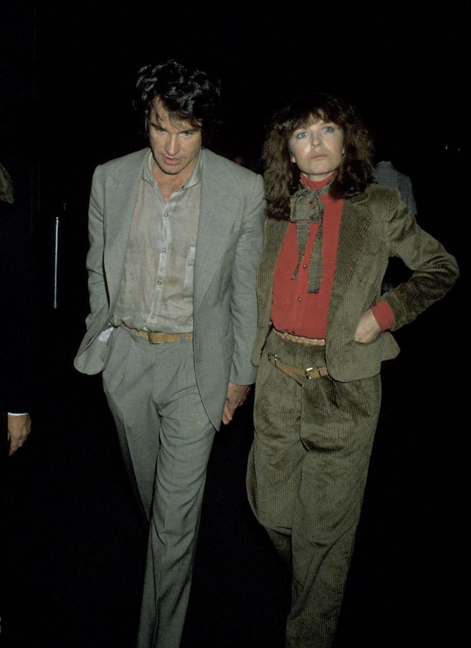 <p>Diane Keaton has always been known for raising the bar of menswear-inspired looks. Here, she channels boyfriend Warren Beatty in a corduroy suit. (Are they wearing the same belt?!)</p>