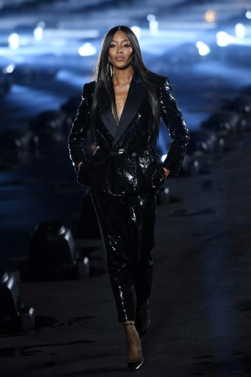 'Misogyny and racism are in the eye of the other,' said Saint Laurent's Anthony Vaccarello, who pointedly closed his Paris show with black supermodel Naomi Campbell (AFP Photo/Christophe ARCHAMBAULT)