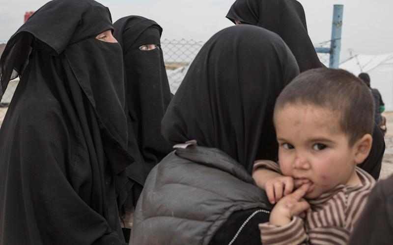 Women gather in the section for foreign families at the al-Hol,near Hasakeh in Syria – a camp which is now home to those who are displaced after living under the Islamic State - The Telegraph