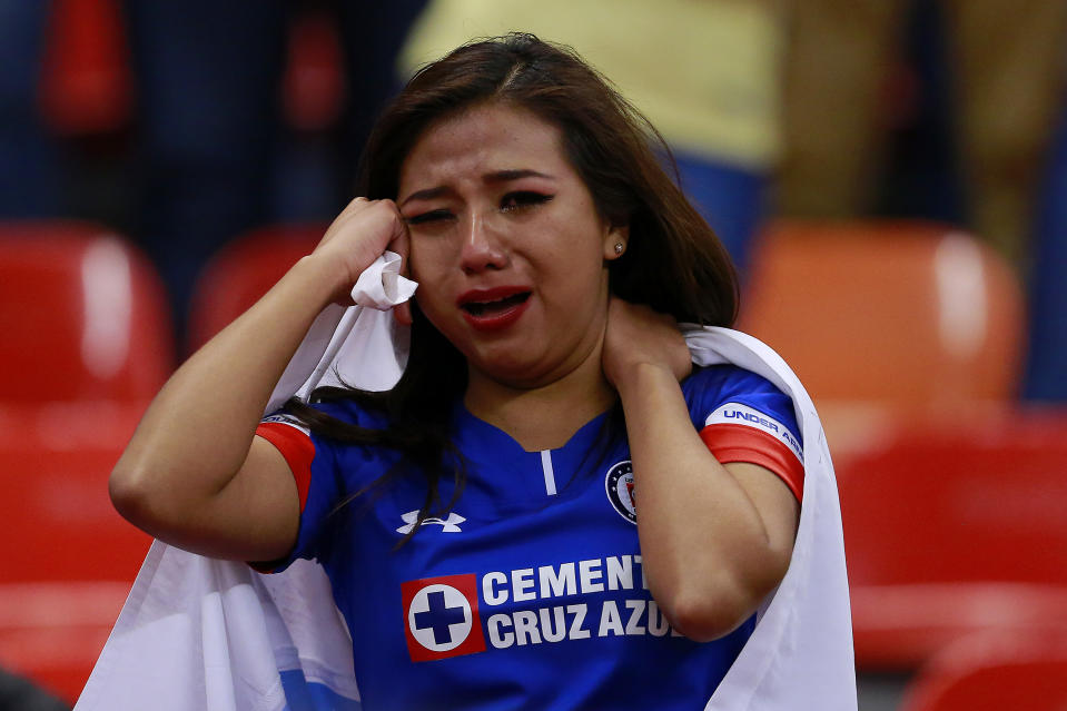MEXICO CITY, MEXICO - DECEMBER 16: Supporter of Cruz Azul reacts during the final second leg match between Cruz Azul and America as part of the Torneo Apertura 2018 Liga MX at Azteca Stadium on December 16, 2018 in Mexico City, Mexico. (Photo by Mauricio Salas/Jam Media/Getty Images)