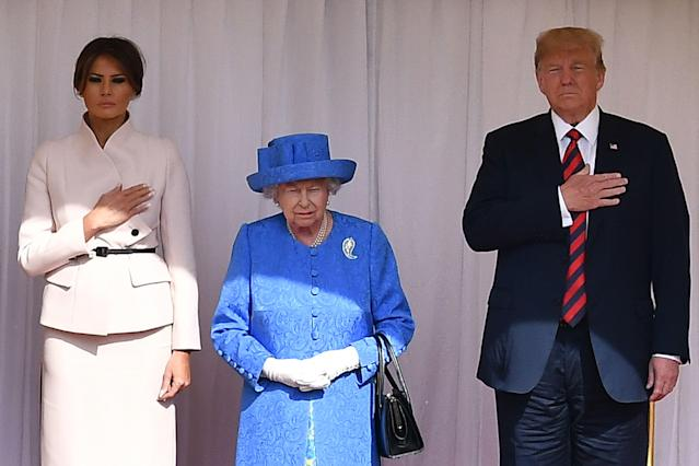 <p>To meet the Queen, Melania opted for a respectful pale pink blazer and skirt from Christian Dior, along with a brown belt, and Christian Louboutin pumps. <em>[Photo: Getty]</em> </p>