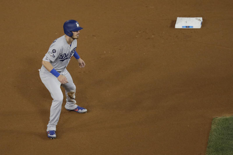 Los Angeles Dodgers' Cody Bellinger leads off from second base against the Washington Nationals during the fourth inning of Game 4 of a baseball National League Division Series Monday, Oct. 7, 2019, in Washington. (AP Photo/Julio Cortez)