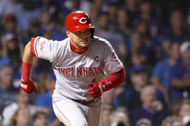 Cincinnati Reds' Jose Iglesias watches his RBI double during the 10th inning of the team's baseball game against the Chicago Cubs on Wednesday, Sept. 18, 2019, in Chicago. The Reds won 3-2 in 10 innings. (AP Photo/Charles Rex Arbogast)