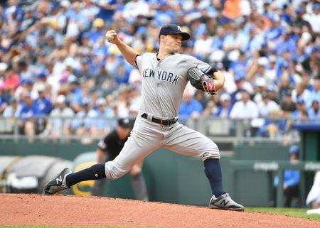 May 20, 2018; Kansas City, MO, USA; New York Yankees starting pitcher Sonny Gray (55) delivers a pitch in the first inning against the Kansas City Royals at Kauffman Stadium. Mandatory Credit: Denny Medley-USA TODAY Sports
