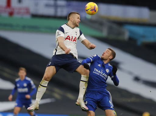 Tottenham's Eric Dier heads the ball clear as Leicester's Jamie Vardy looks up during the English Premier League soccer match between Tottenham Hotspur and Leicester City at the White Hart Lane stadium in London Sunday, Dec. 20, 2020. (AP Photo/Frank Augstein, Pool)