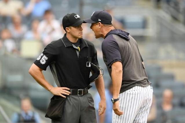 New York Yankees manager Aaron Boone argues with plate umpire Brennan Miller in a game against Tampa Bay, an outburst that earned Boone a one-game suspension by Major League Baseball (AFP Photo/Sarah Stier)