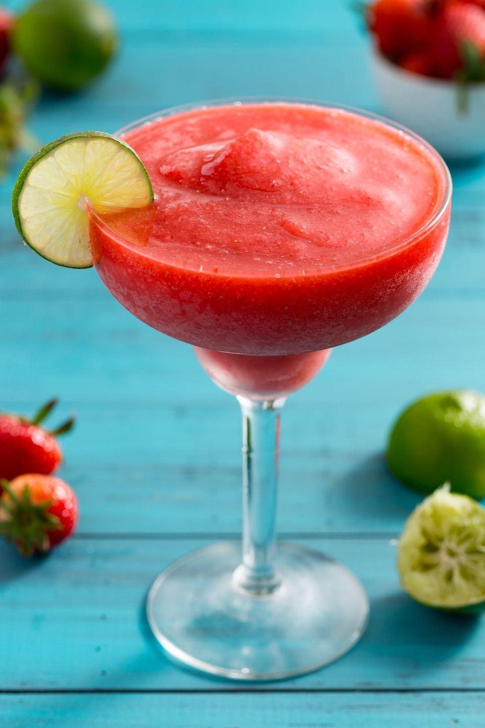 """<p>Sweet strawberries are even better with rum.</p><p>Get the recipe from <a href=""""https://www.delish.com/cooking/recipe-ideas/recipes/a4298/strawberry-daiquiri-frozen-drinks/"""" rel=""""nofollow noopener"""" target=""""_blank"""" data-ylk=""""slk:Delish"""" class=""""link rapid-noclick-resp"""">Delish</a>. </p>"""