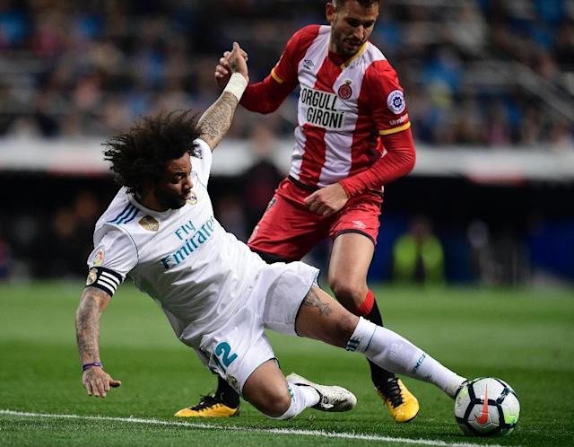 Despite boasting a trio of Neymar's PSG teammates: Silva, Marquinhos and Dani Alves, Brazil have a weakness at left-back should something happen to Real Madrid's Marcelo (L) (AFP Photo/JAVIER SORIANO)
