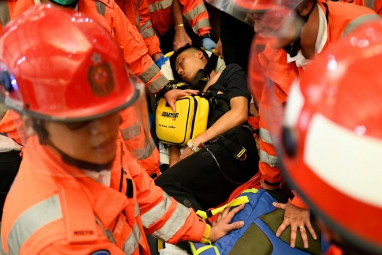 Two men were beaten by protesters at Hong Kong airport on Tuesday, one accused of being a Chinese spy and the other of being an undercover police officer (AFP Photo/Manan VATSYAYANA)
