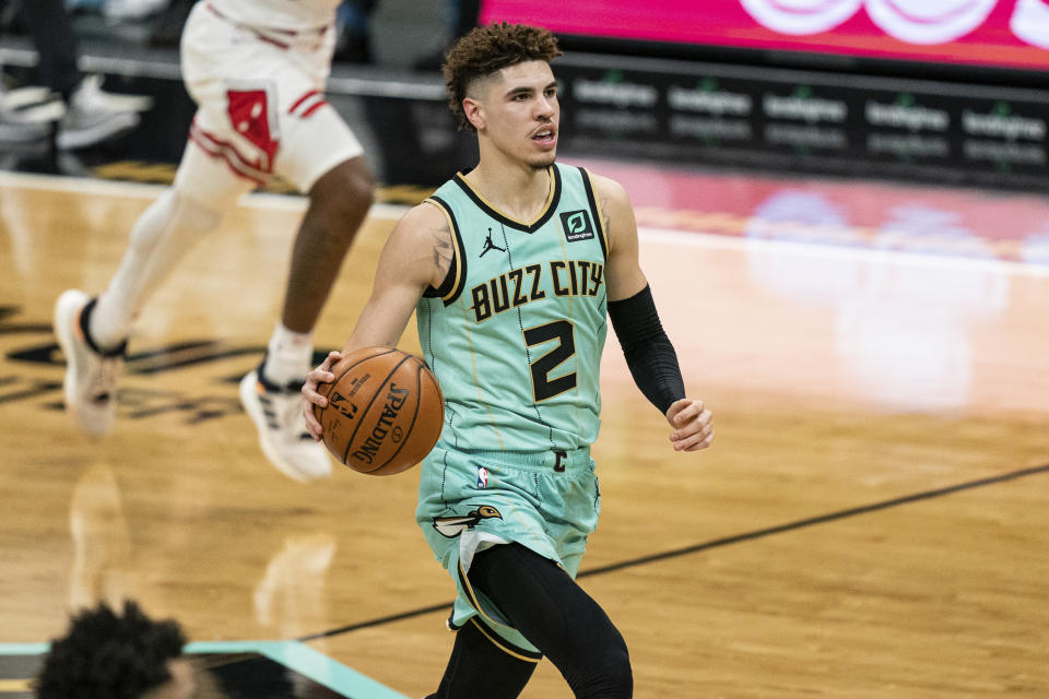 Charlotte Hornets guard LaMelo Ball (2) brings the ball up court against the Chicago Bulls during an NBA basketball game in Charlotte, N.C., Friday, Jan. 22, 2021. (AP Photo/Jacob Kupferman)