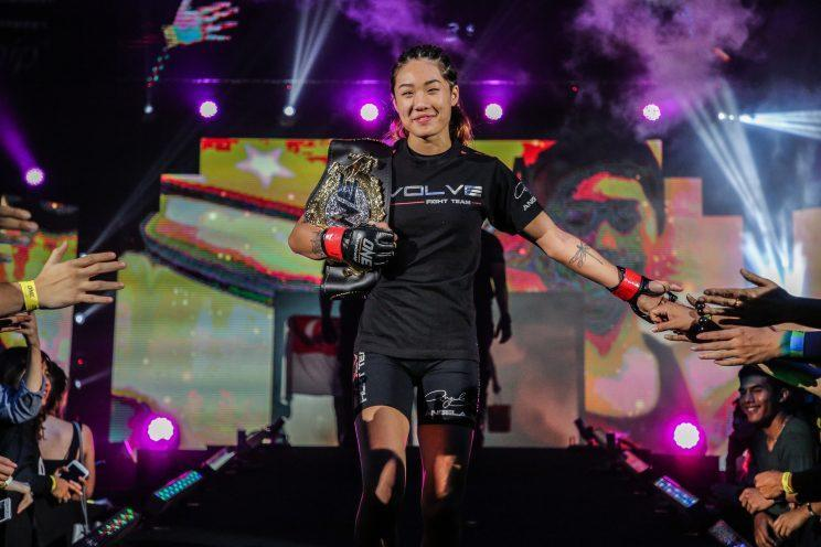 Angela Lee (center, with belt) celebrates after her submission win over Jenny Huang in March. (Credit: ONE Championship)