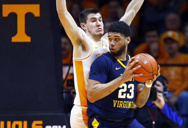 West Virginia forward Esa Ahmad (23) works for a shot as Tennessee forward John Fulkerson defends in the second half of an NCAA college basketball game Saturday, Jan. 26, 2019, in Knoxville, Tenn. Tennessee won 83-66. (AP Photo/Wade Payne)