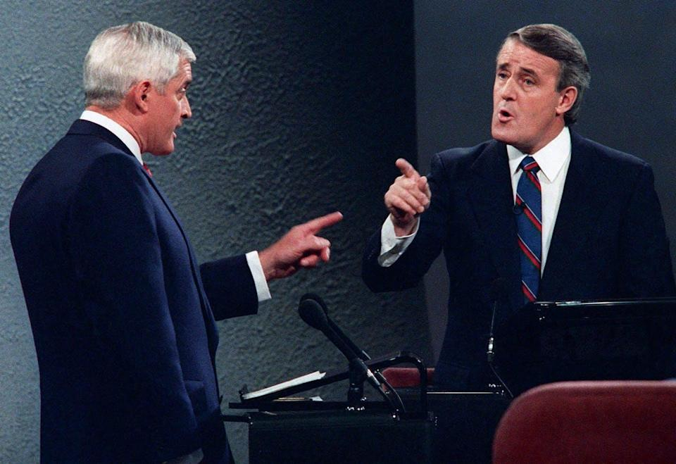 John Turner and Brian Mulroney point fingers at one another during a debate.
