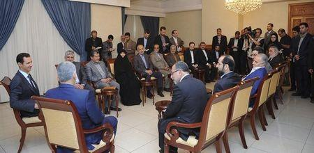 Syria's President Bashar al-Assad (L) meets an Iranian parliamentary delegation headed by Alaeddin Boroujerdi, Chairman of Iranian Parliament's National Security and Foreign Policy Commission (2nd L), in Damascus June 5, 2014, in this handout photograph distributed by Syria's national news agency SANA. REUTERS/SANA/Handout via Reuters