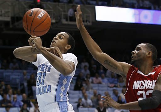 North Carolina's John Henson (31) and Nicholls State's Trevon Lewis battle for a rebound during the first half of an NCAA college basketball game in Chapel Hill, N.C., Monday, Dec. 19, 2011. (AP Photo/Gerry Broome)