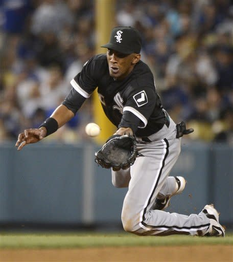 Chicago White Sox shortstop Alexei Ramirez dives as he catches a ball hit by Los Angeles Dodgers' Jerry Hairston Jr. during the fourth inning of a baseball game, Saturday, June 16, 2012, in Los Angeles. (AP Photo/Mark J. Terrill)