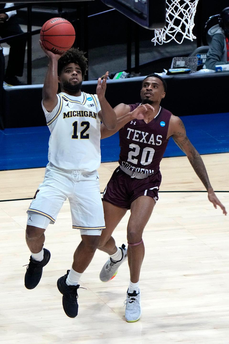 Michigan guard Mike Smith shoots against Texas Southern guard Michael Weathers during the first round of the NCAA tournament March 20, 2021.