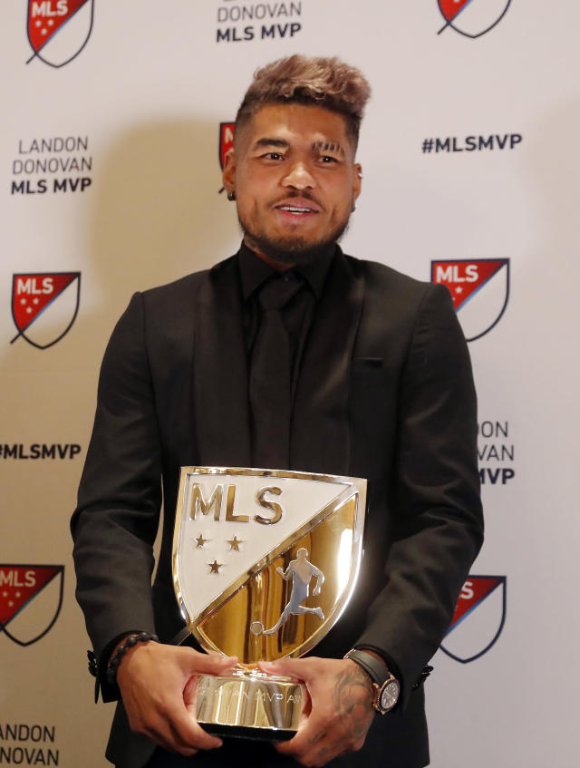 Atlanta United soccer player Josef Martinez poses with the trophy after he was presented with the Landon Donovan MLS MVP award, Wednesday, Dec. 5, 2018, in Atlanta. (AP Photo/John Bazemore)