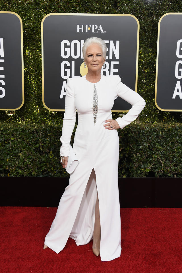 <p>Sexy at 60! Curtis looked radiant in a white Alexander McQueen gown.<br />Image via Getty Images. </p>