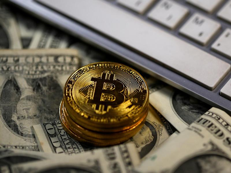 Bitcoin (virtual currency) coins placed on Dollar banknotes, next to computer keyboard, are seen in this illustration picture, November 6, 2017: REUTERS/Dado Ruvic