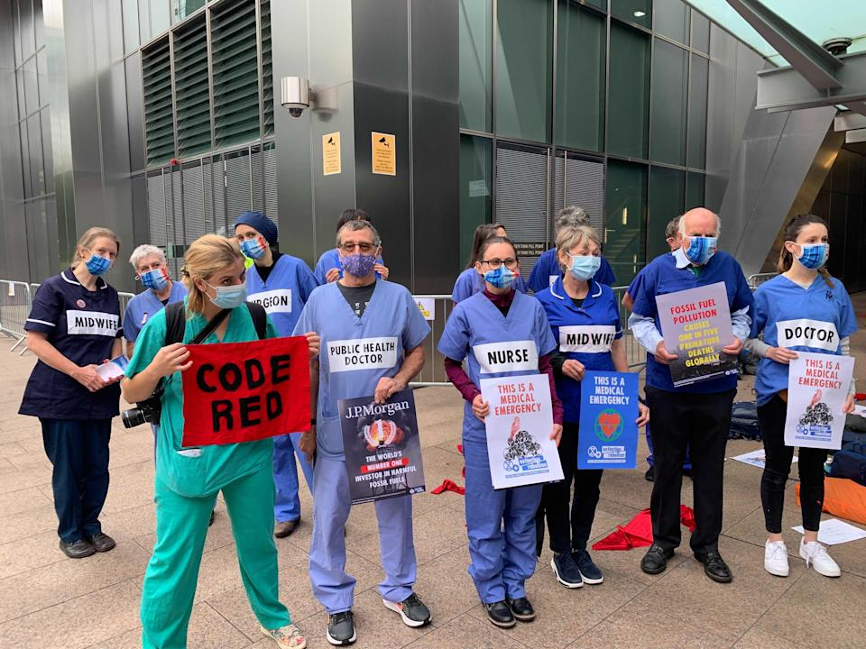 Protesters held banners saying 'code red' and 'this is a medical emergency' (The Independent)
