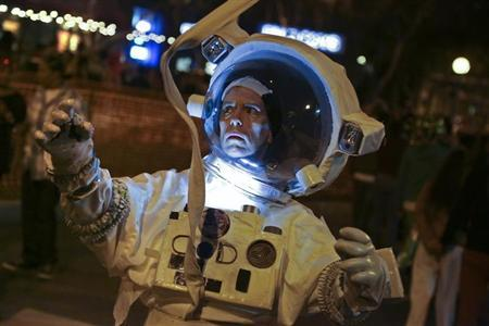 "Coffey dresses as a character from the movie ""Gravity"" at the West Hollywood Halloween Costume Carnaval, in West Hollywood, California"