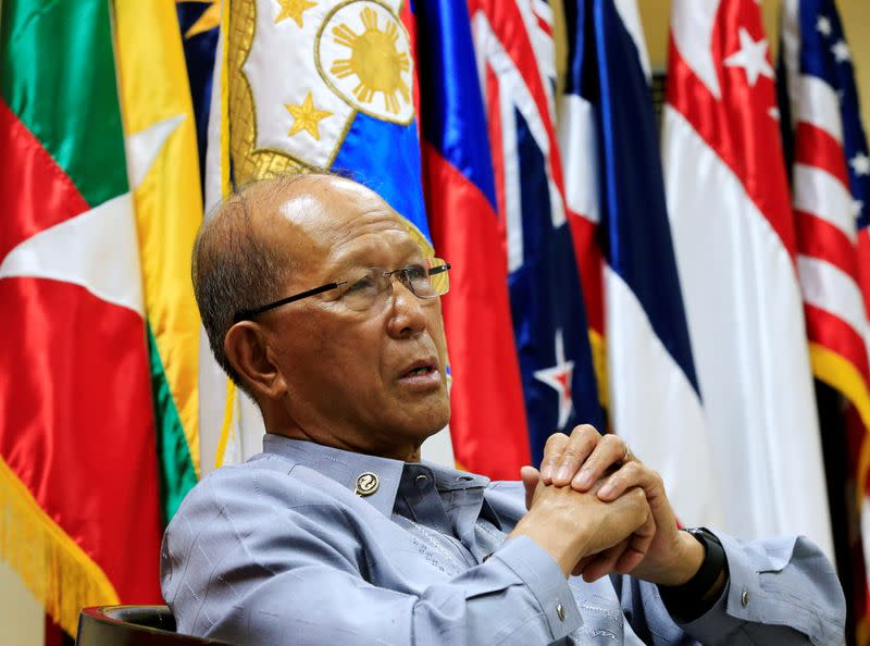 FILE PHOTO: Philippine Defence Secretary Delfin Lorenzana answer questions during a Reuters interview at the military headquarters of Camp Aquinaldo in Quezon city, metro Manila