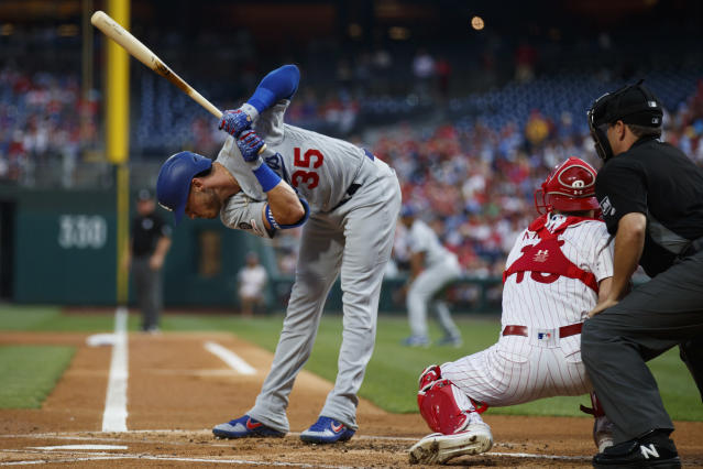 Los Angeles Dodgers' Cody Bellinger, left, dodges a pitch from Philadelphia Phillies starting pitcher Nick Pivetta during the first inning of a baseball game, Wednesday, July 17, 2019, in Philadelphia. At center is catcher Andrew Knapp and at right is umpire Jansen Visconti. (AP Photo/Matt Slocum)
