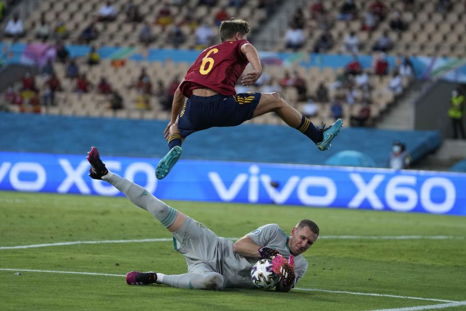 Sweden's goalkeeper Robin Olsen saves on an attempt to score by Spain's Marcos Llorente during the Euro 2020 soccer championship group E match between Spain and Sweden at La Cartuja stadium in Seville, Monday, June 14, 2021. (AP Photo/Thanassis Stavrakis, Pool)