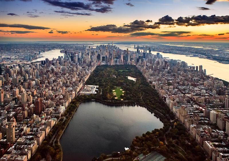 Aerial view of New York City captured from above the Central Park at sunset.