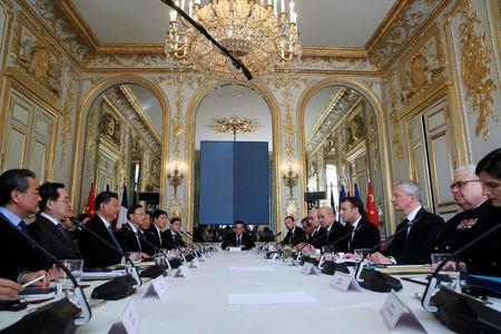 French President Emmanuel Macron attends a meeting with Chinese President Xi Jinping at the Elysee Palace in Paris, France, March 25, 2019.   REUTERS/Gonzalo Fuentes/Pool