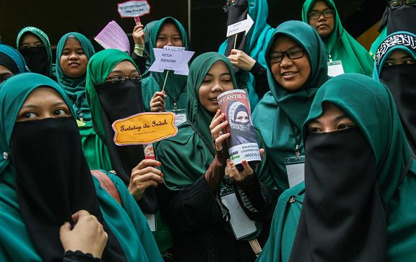<p>Malaysian Muslim women from MOCA (Malaysians on covering Aurah) attend an anti-Valentines day campaign to educate people about Aurah, on February 14, 2016 in Kuala Lumpur, Malaysia. In Malaysia, Muslims (who account for over 60% the population) are prohibited from celebrating Valentine's day following a fatwa (religious ruling) issued in 2005. Five countries have banned Valentine's day including Malaysia, Russian, Iran, Saudi Arabia and Indonesia who mainly have Islamic populations. Photo – Getty </p>