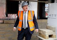 Britain's Prime Minister Boris Johnson gestures during a visit to a construction site in Warrington, north west England on August 6, 2020, as the government announce a major overhaul of planning policy in England. (Photo by PHIL NOBLE / POOL / AFP) (Photo by PHIL NOBLE/POOL/AFP via Getty Images)