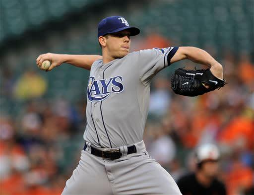 Tampa Bay Rays pitcher Jeremy Hellickson delivers against the Baltimore Orioles in the first inning of a baseball game Friday, May 17, 2013 in Baltimore. (AP Photo/Gail Burton)