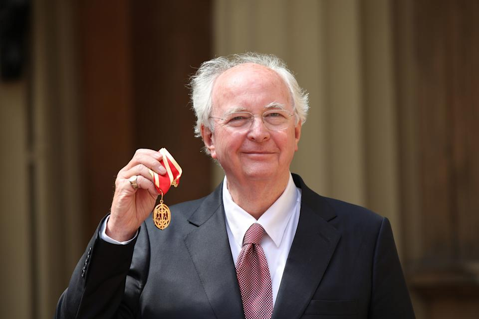 Sir Philip Pullman poses with his medal after receiving a knighthood at Buckingham Palace on May 16, 2019. (Photo by Yui Mok/AFP via Getty Images)