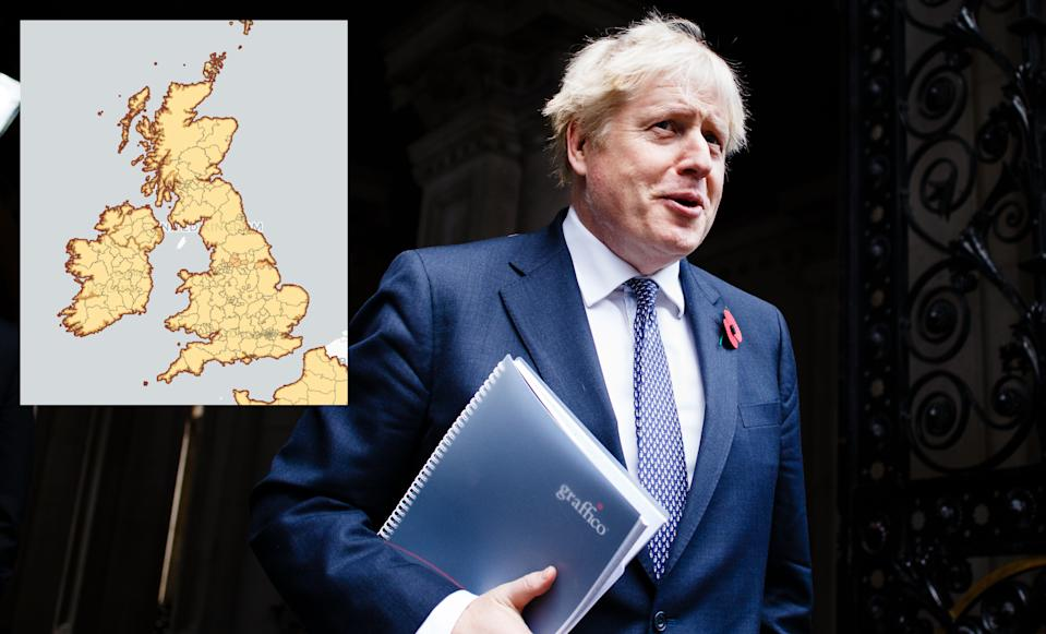 Boris Johnson is set to announce a temporary easing of restrictions over Christmas. A map, inset, shows the risk of catching COVID in each area of the UK. (David Cliff/NurPhoto via Getty Images)
