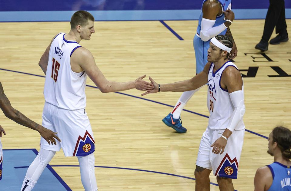 Even with all their injuries, Nikola Jokic believes that he and Aaron Gordon (left) can help lead the Nuggets to their first NBA title.