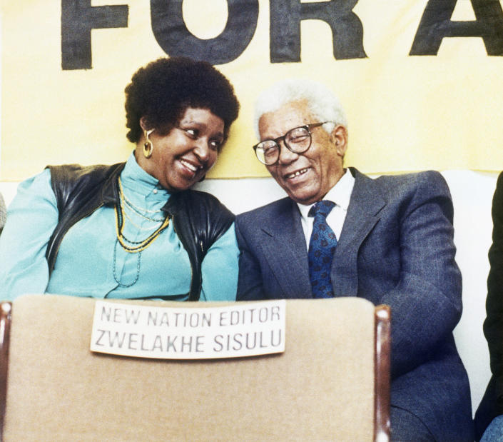 <p>Winnie Mandela, left, talks to recently released ANC leader Walter Sisulu, right, whose son Zwelakhe, editor of the New Nation newspaper under a banning order, may not attend public functions or work as a journalist, at a press conference on Nov. 11, 1989, on the possible suspension of the New Nation by the government. (Photo: Anna Zieminski/AP) </p>