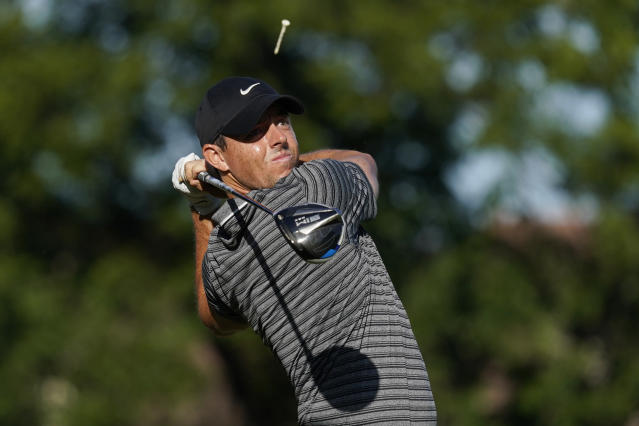 Rory McIlroy, of Northern Ireland, tees off on the 11th hole during the second round of the Charles Schwab Challenge golf tournament at the Colonial Country Club in Fort Worth, Texas, Friday, June 12, 2020. (AP Photo/David J. Phillip)
