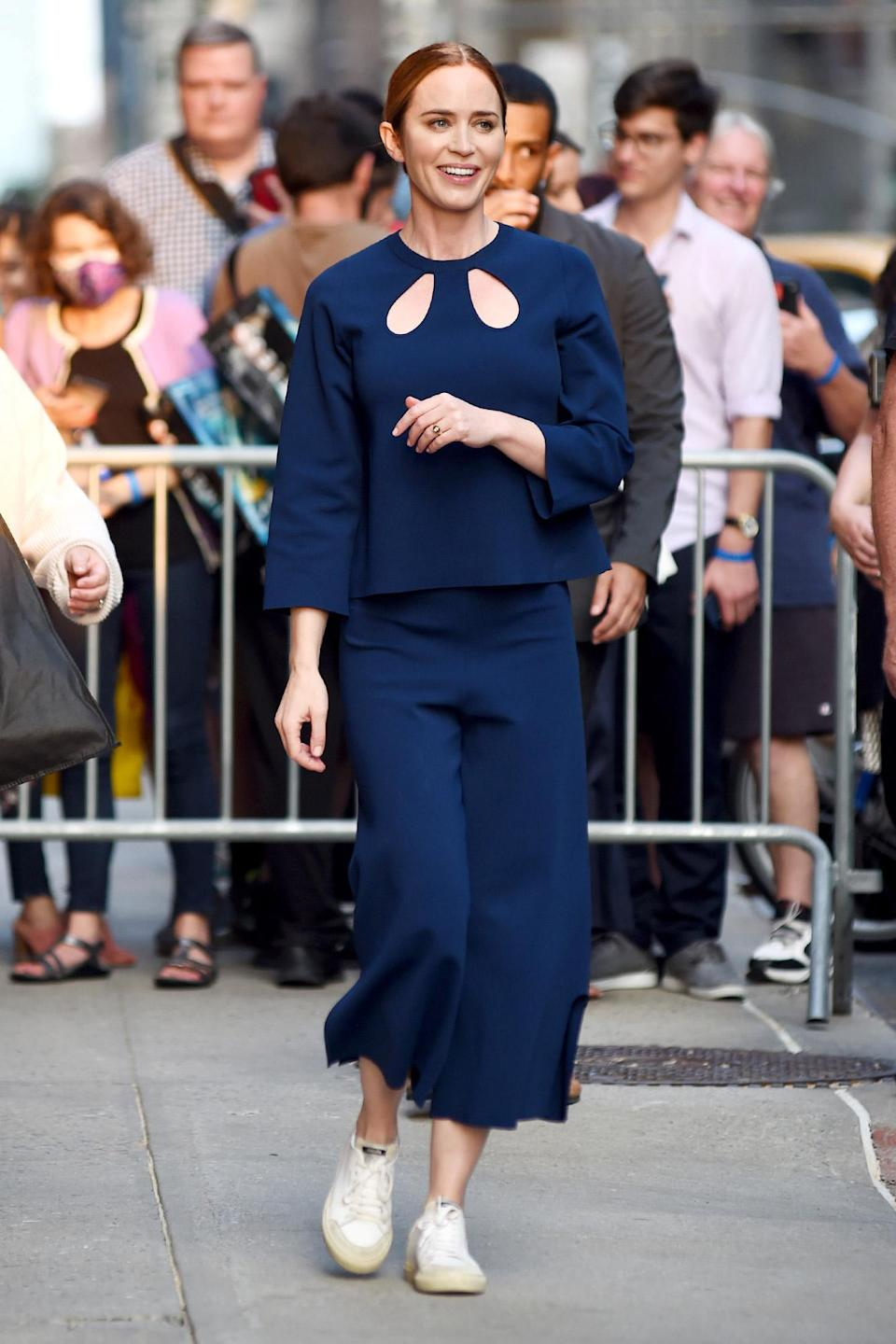 <p>Emily Blunt smiles outside of <em>The Late Show with Stephen Colbert</em> on July 15 in N.Y.C.</p>